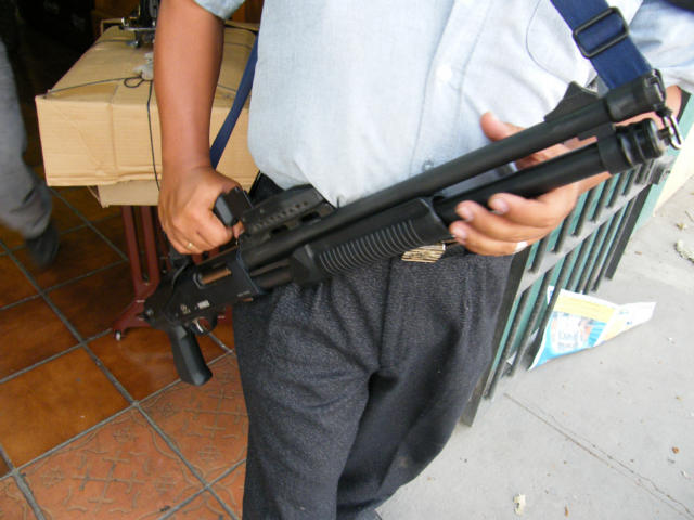 Sawed Off Shotgun in front of Hogar Store or Furniture store in Antigua
