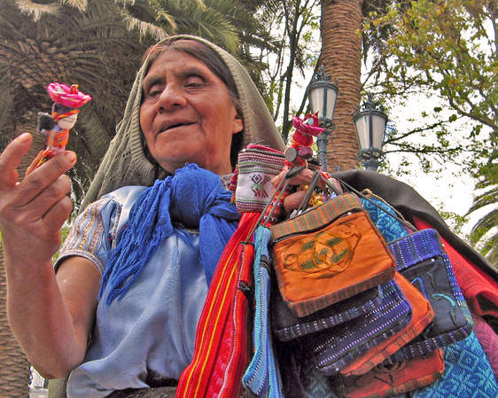 A native Maya woman selling her wares at the Central Plaza in Merida, Yucatan, Guatemala.