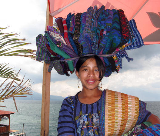 Young Maya girl selling hand woven items at Panajachel, Lago Atitlan, Guatemala.