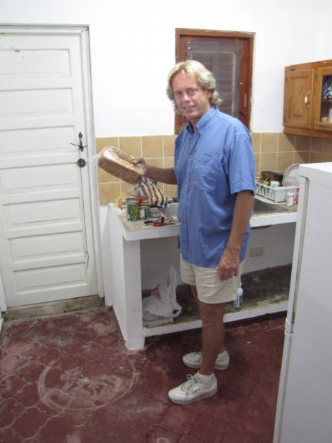 Andy Graham cooking in Sosua Domincan Republic in a 250 USD per month apartment with WIFI and color TV.