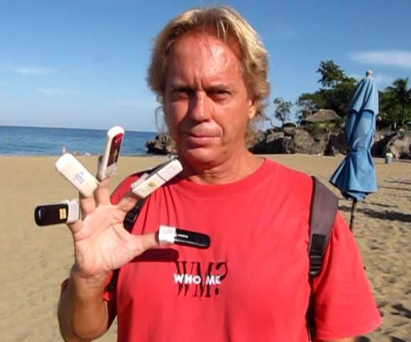Andy Graham in Sosua, Domincan Republic showing off 5 USB Wireless Internet Modems and why I am a Digital Nomad.