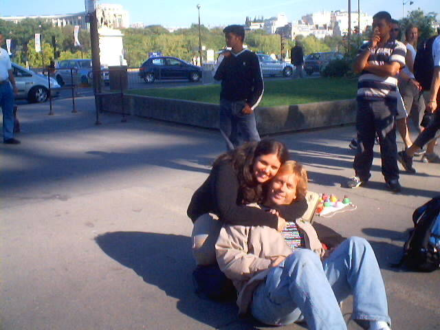 Andy Graham lying on ground under Eiffel Tower in Paris, France with two Israel Girls.
