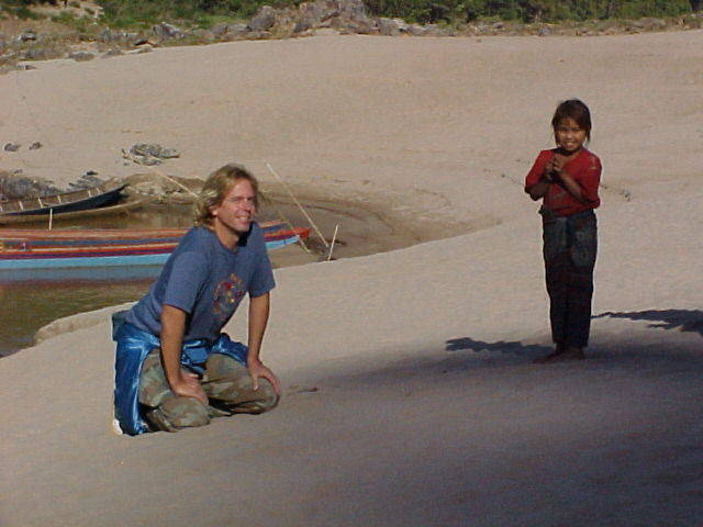 Andy Graham on Mekong River with a Little Cambodia Girl.