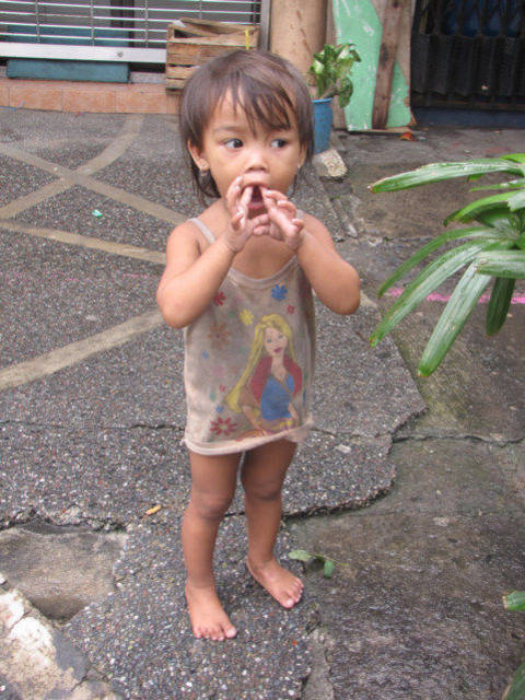 Filipina Child in Manila sent by Mother to Beg
