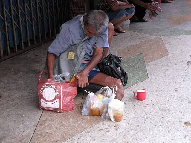 Thailand beggar with leg missing.