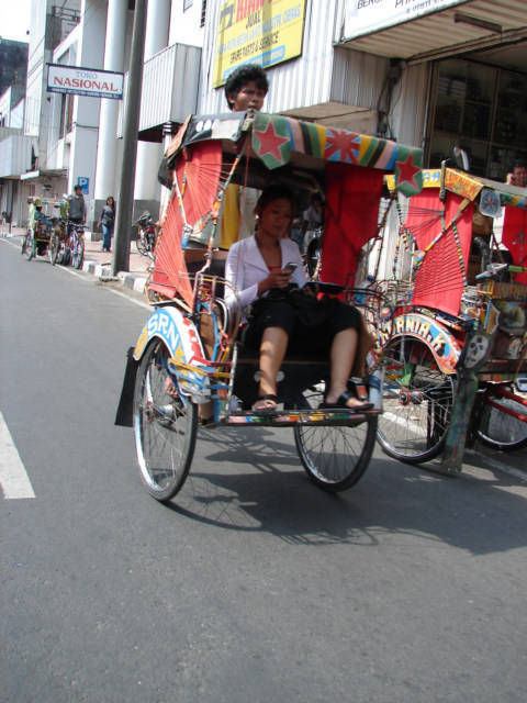 Female riding a rickshaw