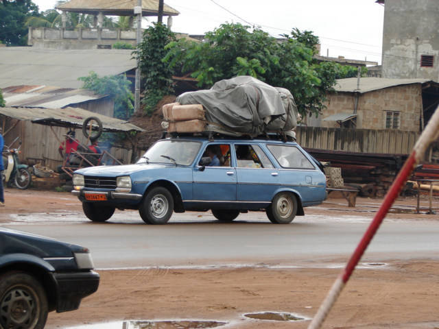 Group taxi with a very heavy load to transport.