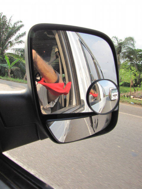 A Tro Tro van passed a car in Ghana, the passenger mirror was broken. If my arm would have been outside, it could have been removed. title=
