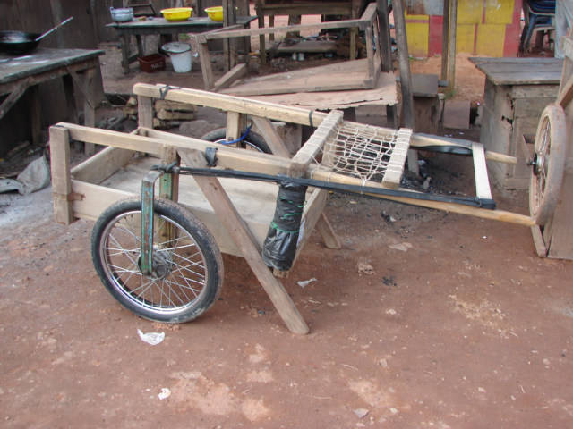 Parked simple steel and wooden cart.