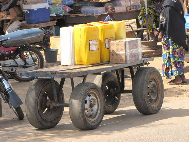 Yellow water container on a cart.