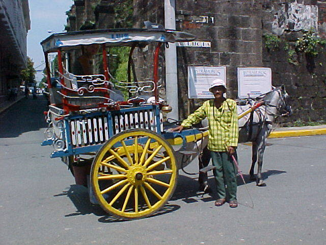 Yellow wheeled carriage with a yellow polo driver.