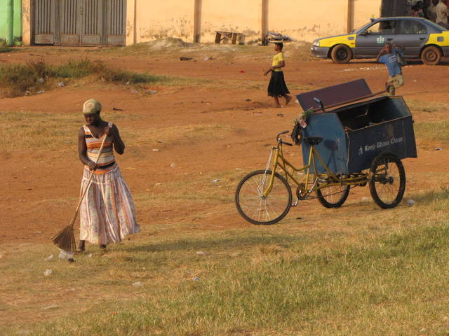 Girl Hauling Trash with Bicycle