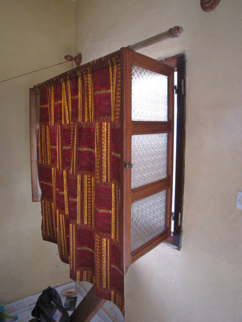 I moved the curtain rod forward in my Via Via Auberge room in Yoff Senegal. This allowed me to have more air in the room, yet still having privacy. I wish there was a way for all curtains to do this. title=