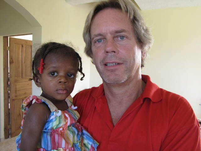 Andy Graham in Haiti with an african kid