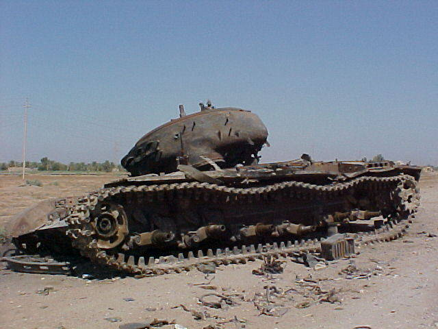 Iraq tank along side the road between Mosul and Bagdad, Iraq in August of 2003.